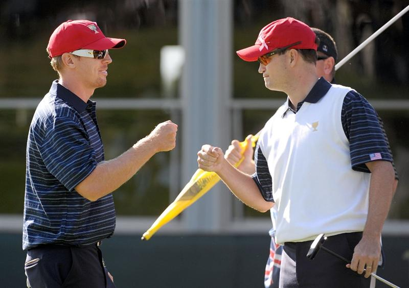 SAN FRANCISCO - OCTOBER 09:  Zach Johnson and Hunter Mahan of the USA Team celebrate a win of the 14th hole during the Day Two Fourball Matches of The Presidents Cup at Harding Park Golf Course on October 9, 2009 in San Francisco, California.  (Photo by Harry How/Getty Images)