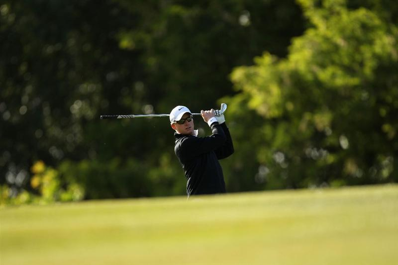 VIRGINIA WATER, ENGLAND - MAY 26:  Simon Dyson of England practice swing ahead of his second shot on the first hole during the first round of the BMW PGA Championship at Wentworth Club on May 26, 2011 in Virginia Water, England.  (Photo by Ian Walton/Getty Images)