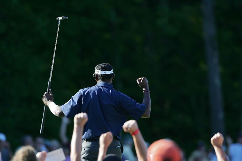 NORTON, MA - SEPTEMBER 01:  Vijay Singh of Fiji Islands celebrates a birdie on the 14th green during the final  round of the Deutsche Bank Championship at TPC of Boston held on September 1, 2008 in Norton, Massachusetts.  (Photo by Michael Cohen/Getty Images)