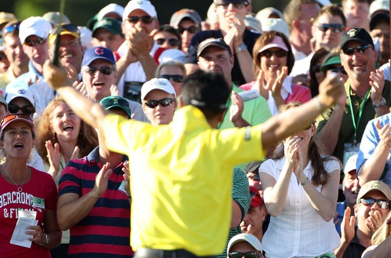 AUGUSTA, GA - APRIL 10:  Patrons cheer as Y.E. Yang of South Korea celebrate making birdie on the 18th hole during the third round of the 2010 Masters Tournament at Augusta National Golf Club on April 10, 2010 in Augusta, Georgia.  (Photo by Jamie Squire/Getty Images)