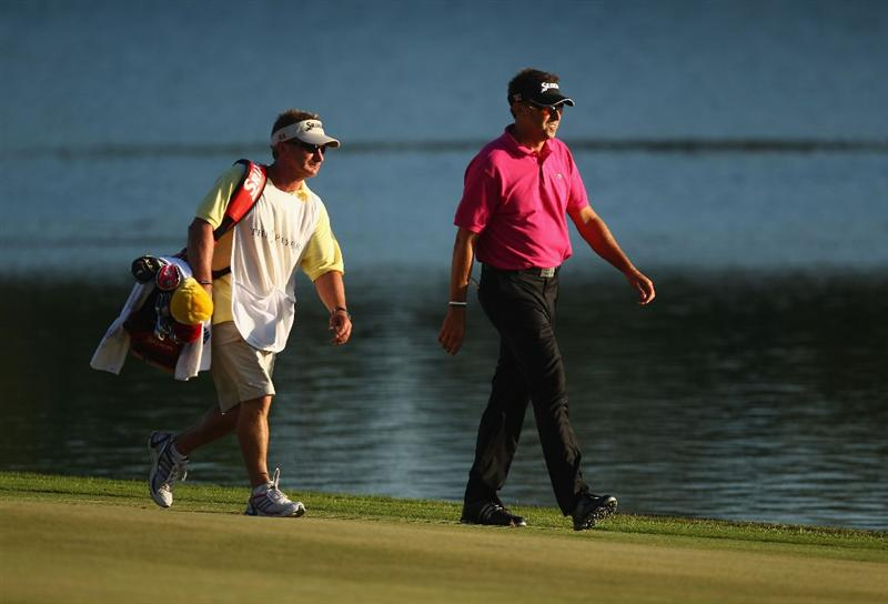 PONTE VEDRA BEACH, FL - MAY 09:  Robert Allenby of Australia (R) and caddie Colin Burwood walk the 18th fairway during the final round of THE PLAYERS Championship held at THE PLAYERS Stadium course at TPC Sawgrass on May 9, 2010 in Ponte Vedra Beach, Florida.  (Photo by Richard Heathcote/Getty Images)