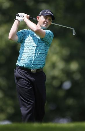 GRAND BLANC, MI - AUGUST 02: Greg Chalmers of Australia watches his second shot on the first hole during the final round of the Buick Open at Warwick Hills Golf and Country Club on August 2, 2009 in Grand Blanc, Michigan.  (Photo by Gregory Shamus/Getty Images)