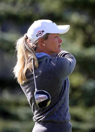 CALGARY, AB - SEPTEMBER 04 : Suzann Pettersen of Norway watches her tee shot on the 18th hole during the second round of the Canadian Women's Open at Priddis Greens Golf & Country Club on September 4, 2009 in Calgary, Alberta, Canada. (Photo by Hunter Martin/Getty Images)