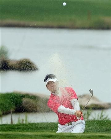 SUZHOU, CHINA - APRIL 18:  Y.E. Yang of Korea plays a bunker shot on the 1st hole during the Round Four of the Volvo China Open on April 18, 2010 in Suzhou, China.  (Photo by Victor Fraile/Getty Images)