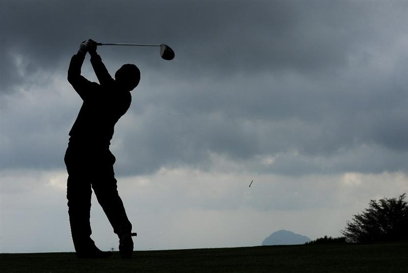 JEJU, SOUTH KOREA - APRIL 25:  Thongchai Jaidee of Thailand plays his tee shot on the 10th hole during the third round of the Ballantine's Championship at Pinx Golf Club on April 25, 2009 in Jeju, South Korea.  (Photo by Stuart Franklin/Getty Images)