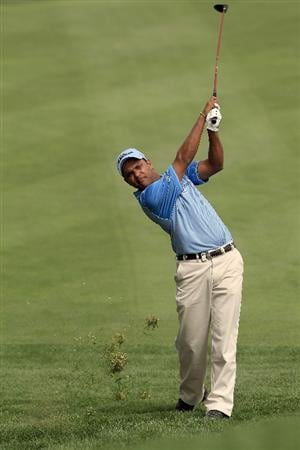 DUBAI, UNITED ARAB EMIRATES - FEBRUARY 04:  S S P Chowrasia of India plays his second shot to the par 4, 9th hole during the first round of the 2010 Omega Dubai Desert Classic on the Majilis Course at the Emirates Golf Club on February 4, 2010 in Dubai, United Arab Emirates.  (Photo by David Cannon/Getty Images)