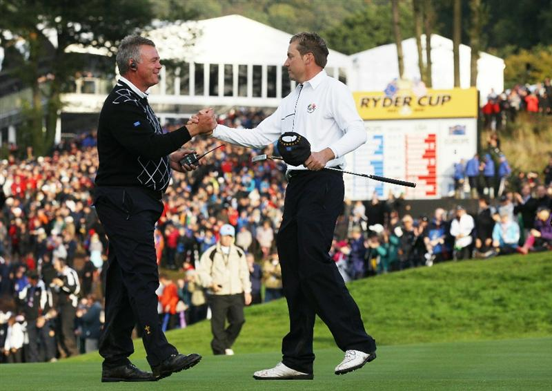 NEWPORT, WALES - OCTOBER 03:  Europe Vice Captain Darren Clarke (L) shakes hands with Ian Poulter on the 17th green during the Fourball & Foursome Matches during the 2010 Ryder Cup at the Celtic Manor Resort on October 3, 2010 in Newport, Wales.  (Photo by David Cannon/Getty Images)