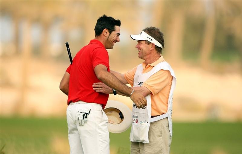 DOHA, QATAR - JANUARY 25:  Alvaro Quiros of Spain celebrates with his caddie Dave McNeilly on the 18th green after winning the Commercialbank Qatar Masters at Doha Golf Club on January 25, 2009 in Doha, Qatar.  (Photo by Andrew Redington/Getty Images)