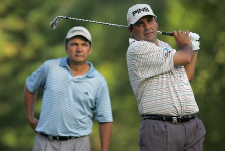 TULSA, OK - AUGUST 08:  Angel Cabrera of Argentina watches a shot as Jose Coceres looks on during a practice round prior to the start of the 89th PGA Championship at the Southern Hills Country Club on August 8, 2007 in Tulsa, Oklahoma.  (Photo by Jeff Gross/Getty Images)