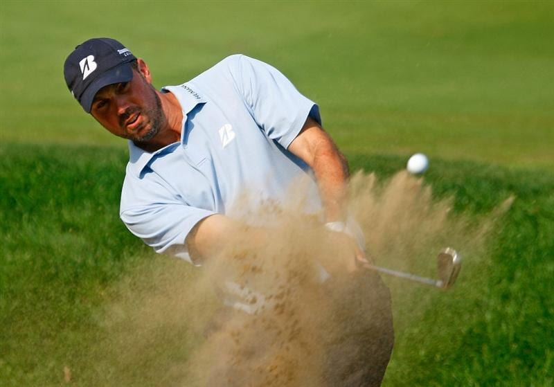 LEMONT, IL - SEPTEMBER 12:  Matt Kuchar hits a bunker shot on the 18th hole during the third round of the BMW Championship held at Cog Hill Golf & CC on September 12, 2009 in Lemont, Illinois.  (Photo by Scott Halleran/Getty Images)