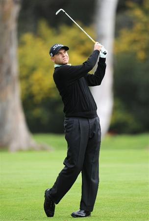 PACIFIC PALISADES, CA - FEBRUARY 18:  Bill Haas plays his approach shot on the 13th hole during the second round of the Northern Trust Open at Riviera Country Club on February 18, 2011 in Pacific Palisades, California.  (Photo by Stuart Franklin/Getty Images)