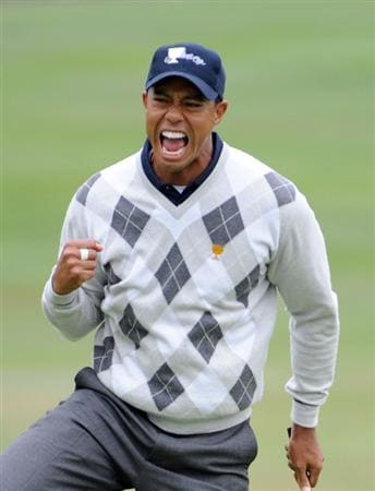 SAN FRANCISCO - OCTOBER 10:  Tiger Woods of the USA Team celebrates his putt for a birdie to win the 17th hole during the Day Three Morning Foursome Matches of The Presidents Cup at Harding Park Golf Course on October 10, 2009 in San Francisco, California.  (Photo by Harry How/Getty Images)
