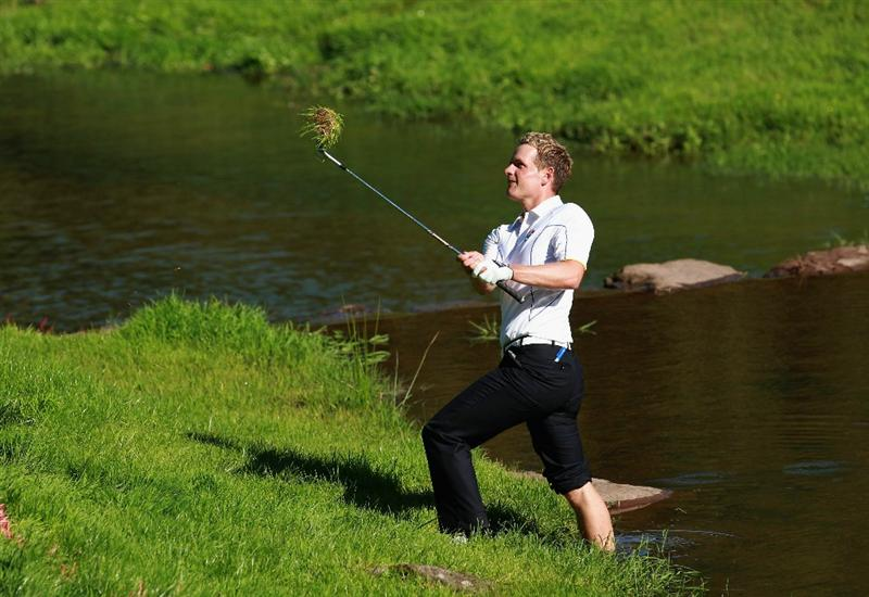 NEWPORT, WALES - OCTOBER 04:  Luke Donald of Europe hits from the rough on the 15th hole in the singles matches during the 2010 Ryder Cup at the Celtic Manor Resort on October 4, 2010 in Newport, Wales. (Photo by Andrew Redington/Getty Images)
