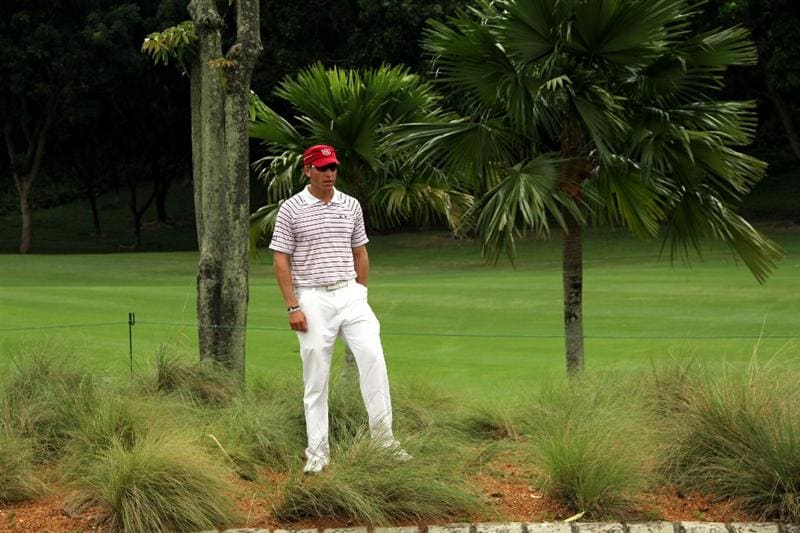 KUALA LUMPUR, MALAYSIA - OCTOBER 30: Ricky Barnes of USA prepares to play his 2nd shot on the rough of the 13th hole during day three of the CIMB Asia Pacific Classic at The MINES Resort & Golf Club on October 30, 2010 in Kuala Lumpur, Malaysia. (Photo by Stanley Chou/Getty Images)