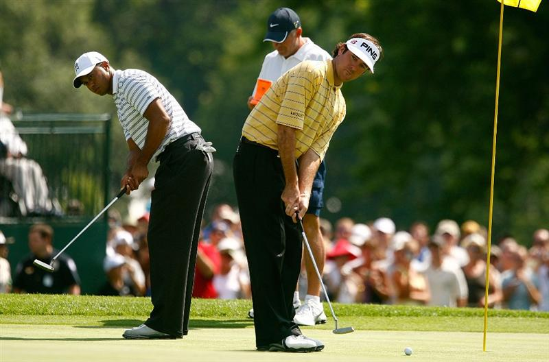 CHASKA, MN - AUGUST 10:  Bubba Watson, (R) and Tiger Woods watch putts on the 18th green during a practice round prior to the start of the 91st PGA Championship at the Hazeltine Golf Club on August 10, 2009 in Chaska, Minnesota.  (Photo by Scott Halleran/Getty Images)