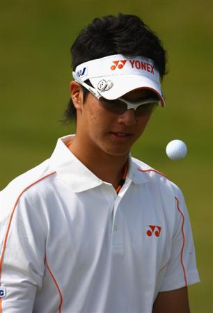 TURNBERRY, SCOTLAND - JULY 15:  Ryo Ishikawa of Japan tosses his ball during a practice round prior to the 138th Open Championship on the Ailsa Course, Turnberry Golf Club on July 15, 2009 in Turnberry, Scotland.  (Photo by Richard Heathcote/Getty Images)