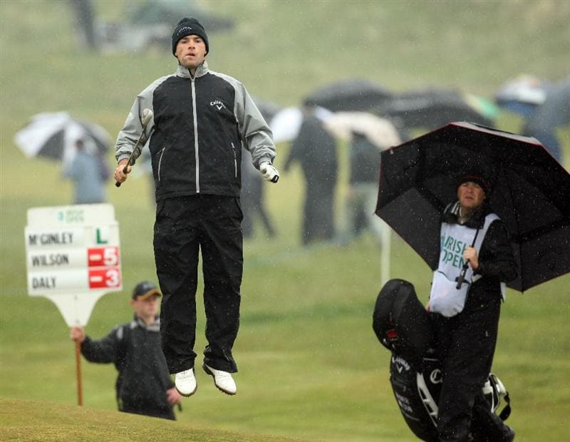 BALTRAY, IRELAND - MAY 14: Oliver Wilson of England jumps on the par four 14th hole during the first round of The 3 Irish Open at County Louth Golf Club on May 14, 2009 in Baltray, Ireland.  (Photo by Ross Kinnaird/Getty Images)