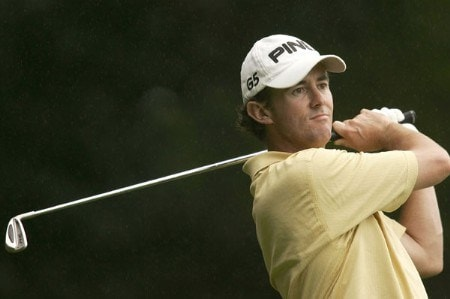 Mark Hensby watches his tee shot during the first round of the 2005 HSBC World Matchplay Championship at Wentworth Golf Club's West Course in Virginia Water, Great Britain on September 15, 2005.Photo by Pete Fontaine/WireImage.com