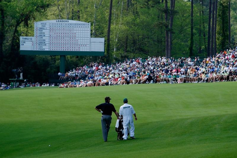 AUGUSTA, GA - APRIL 11:  Kenny Perry waits with his caddie Fred Sanders on the 13th round of the 2009 Masters Tournament at Augusta National Golf Club on April 11, 2009 in Augusta, Georgia.  (Photo by Jamie Squire/Getty Images)