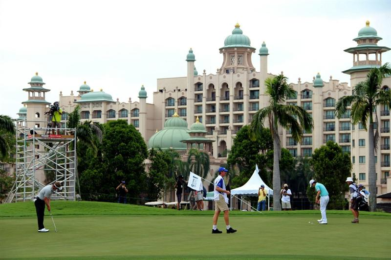 KUALA LUMPUR, MALAYSIA - OCTOBER 28:  Luke Donald of England and Noh-Seung-Yul of South Korea prepare for their putts on the 12th hole during day one of the CIMB Asia Pacific Classic at The MINES Resort & Golf Club on October 28, 2010 in Kuala Lumpur, Malaysia. (Photo by Stanley Chou/Getty Images)
