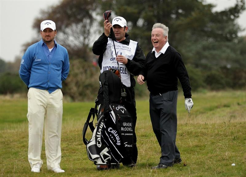 CARNOUSTIE, SCOTLAND - OCTOBER 09:  Graeme McDowell of Northern Ireland with his father and playing partner Kenny McDowell on the 14th hole during the third round of The Alfred Dunhill Links Championship at the Carnoustie Golf Links on October 9, 2010 in Carnoustie, Scotland.  (Photo by Andrew Redington/Getty Images)