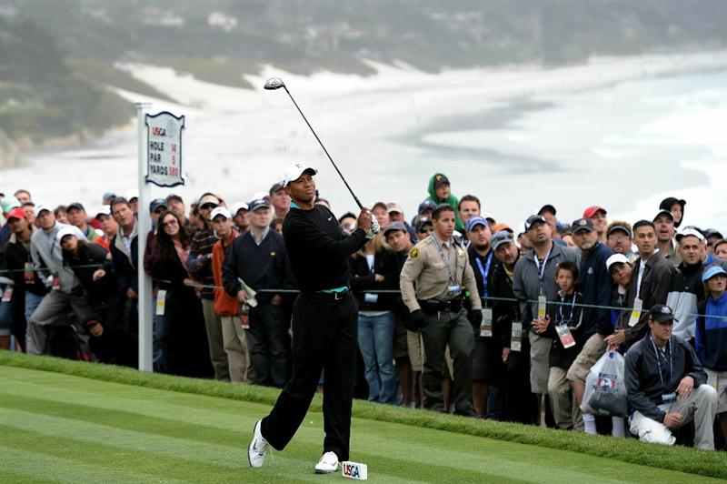 PEBBLE BEACH, CA - JUNE 18:  Tiger Woods hits his tee shot on the 14th hole during the second round of the 110th U.S. Open at Pebble Beach Golf Links on June 18, 2010 in Pebble Beach, California.  (Photo by Harry How/Getty Images)