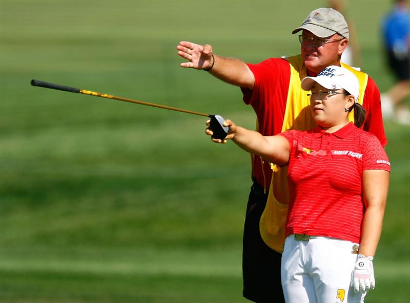 BETHLEHEM, PA - JULY 09:  Jiyai Shin of South Korea chats with her caddie Dean Herden on the first hole during the first round of the 2009 U.S. Women's Open at the Saucon Valley Country Club on July 9, 2009 in Bethlehem, Pennsylvania.  (Photo by Scott Halleran/Getty Images)