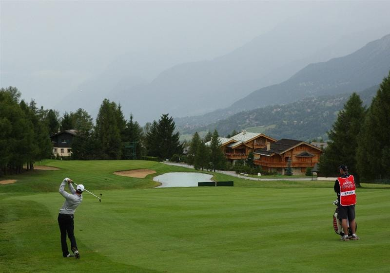 CRANS, SWITZERLAND - SEPTEMBER 04:  Bradley Dredge of Wales hits his second shot on the 14th hole during the first round of the Omega European Masters at Crans-Sur-Sierre Golf Club on September 4, 2008 in Crans Montana, Switzerland.  (Photo by Andrew Redington/Getty Images)