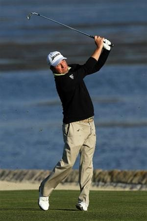 PEBBLE BEACH, CA - JUNE 19:  Tim Clark of South Africa watches his approach shot on the 18th hole during the third round of the 110th U.S. Open at Pebble Beach Golf Links on June 19, 2010 in Pebble Beach, California.  (Photo by Stephen Dunn/Getty Images)