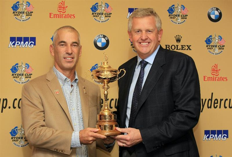 CARDIFF, WALES - SEPTEMBER 27:  USA captain Corey Pavin and European captain Colin Montgomerie pose with the Ryder Cup trophy as the USA team arrive at Cardiff Airport on September 27, 2010 in Cardiff, Wales.  (Photo by David Cannon/Getty Images)