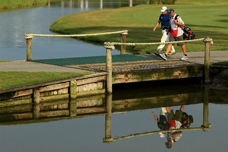 PONTE VEDRA BEACH, FL - MAY 14:  Phil Mickelson walks with his caddie Jim Mackay on the ninth hole during the third round of THE PLAYERS Championship held at THE PLAYERS Stadium course at TPC Sawgrass on May 14, 2011 in Ponte Vedra Beach, Florida.  (Photo by Streeter Lecka/Getty Images)
