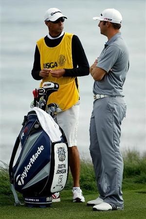 PEBBLE BEACH, CA - JUNE 19:  Dustin Johnson chats with his caddie Bobby Brown during the third round of the 110th U.S. Open at Pebble Beach Golf Links on June 19, 2010 in Pebble Beach, California.  (Photo by Donald Miralle/Getty Images)
