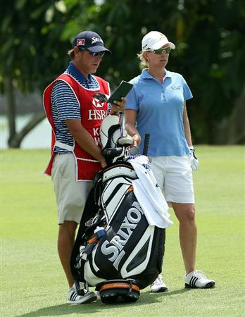 SINGAPORE - FEBRUARY 27:  Karrie Webb of Australia stands with her caddie Michael Paterson on the 17th hole during the final round of the HSBC Women's Champions at the Tanah Merah Country Club on February 27, 2011 in Singapore.  (Photo by Andrew Redington/Getty Images)