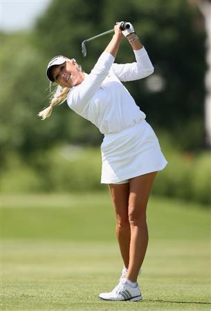 SPRINGFIELD, IL - JUNE 04:  Natalie Gulbis hits her second shot on the fourth hole during the first round of the LPGA State Farm Classic golf tournament at Panther Creek Country Club on June 4, 2009 in Springfield, Illinois.  (Photo by Christian Petersen/Getty Images)