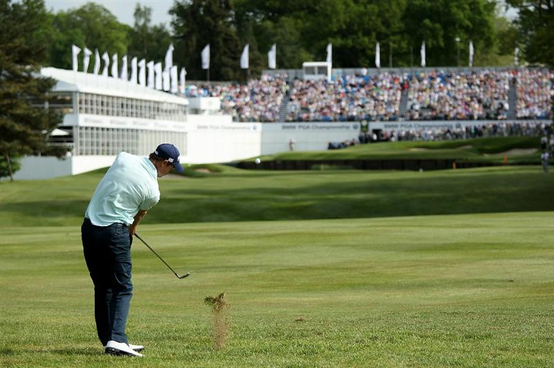 VIRGINIA WATER, ENGLAND - MAY 21:  Rhys Davies of Wales hits his approach shot to the 18th green during the second round of the BMW PGA Championship on the West Course at Wentworth on May 21, 2010 in Virginia Water, England.  (Photo by Andrew Redington/Getty Images)