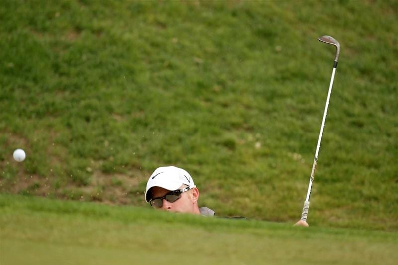 VIRGINIA WATER, ENGLAND - MAY 26:  Simon Dyson of England plays a bunker shot during the first round of the BMW PGA Championship at Wentworth Club on May 26, 2011 in Virginia Water, England.  (Photo by Ross Kinnaird/Getty Images)