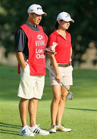 SINGAPORE - FEBRUARY 24:  Lorena Ochoa of Mexico and her caddie are pictured during the Pro-Am for the HSBC Women's Champions at Tanah Merah Country Club on February 24, 2010 in Singapore.  (Photo by Andy Lyons/Getty Images)