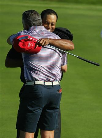NEWPORT, WALES - OCTOBER 04:  Tiger Woods of the USA hugs his caddie Steve Williams on the 15th green after winning 4&3 in the singles matches during the 2010 Ryder Cup at the Celtic Manor Resort on October 4, 2010 in Newport, Wales.  (Photo by Jamie Squire/Getty Images)