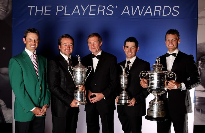 VIRGINIA WATER, ENGLAND - MAY 24:  (L-R)  Charl Schwartzel, Graeme McDowell George O'Grady, Chief Executive of The European Tour, Louis Oosthuizen and Martin Kaymer pose during the European Tour Dinner at The Wentworth Club on May 24, 2011 in Virginia Water, England.  (Photo by Andrew Redington/Getty Images)