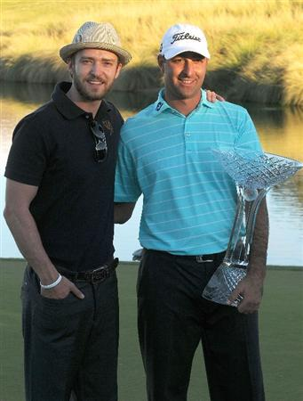 LAS VEGAS- OCTOBER 19:  Marc Turnesa and Justin Timberlake pose with the winners trophy during the fourth and final round of  the Justin Timberlake Shriners Hospitals for Children Open held at the TPC Summerlin on October 19, 2008 in Las Vegas, Nevada.  (Photo by Marc Feldman/Getty Images)