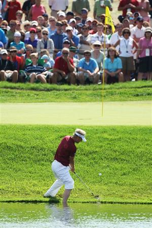 CHASKA, MN - AUGUST 16:  Soren Kjeldsen of Denmark plays a shot from the water's edge on the eighth hole during the final round of the 91st PGA Championship at Hazeltine National Golf Club on August 16, 2009 in Chaska, Minnesota.  (Photo by David Cannon/Getty Images)