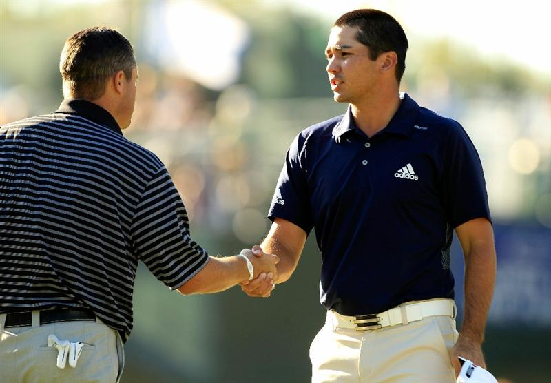 NORTON, MA - SEPTEMBER 04:  Jason Day of Australia shakes hands with Ryan Palmer after he finishes the 18th hole during the second round of the Deutsche Bank Championship at TPC Boston on September 4, 2010 in Norton, Massachusetts.  (Photo by Michael Cohen/Getty Images)