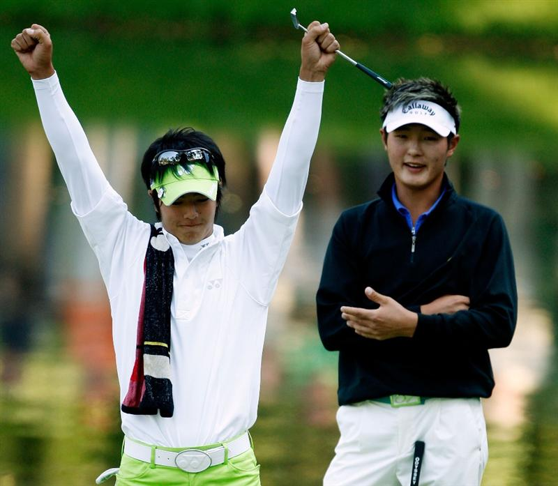 AUGUSTA, GA - APRIL 08:  Ryo Ishikawa of Japan reacts while Danny Lee of New Zealand looks on during the Par 3 Contest prior to the 2009 Masters Tournament at Augusta National Golf Club on April 8, 2009 in Augusta, Georgia.  (Photo by Jamie Squire/Getty Images)