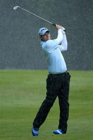 VIRGINIA WATER, ENGLAND - MAY 26:  Gary Boyd of England hits an approach shot as the rain falls during the first round of the BMW PGA Championship at Wentworth Club on May 26, 2011 in Virginia Water, England.  (Photo by David Cannon/Getty Images)