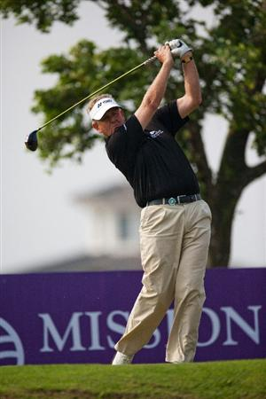 HAIKOU, CHINA - OCTOBER 31: Golfer Colin Montgomerie of Scotland play a shot during day five of the Mission Hills Start Trophy tournament at Mission Hills Resort on October 31, 2010 in Haikou, China. The Mission Hills Star Trophy is Asia's leading leisure liflestyle event which features Hollywood celebrities and international golf stars.  (Photo by Athit Perawongmetha/Getty Images for Mission Hills)
