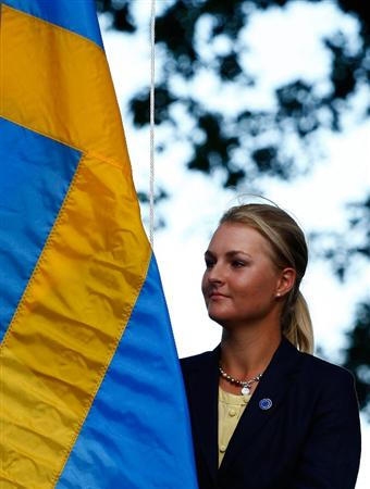 SUGAR GROVE, IL - AUGUST 20:  Anna Nordqvist of the European Team raises the Swedish flag during the Opening Ceremonies prior to the start of the 2009 Solheim Cup at Rich Harvest Farms on August 20, 2009 in Sugar Grove, Illinois.  (Photo by Scott Halleran/Getty Images)