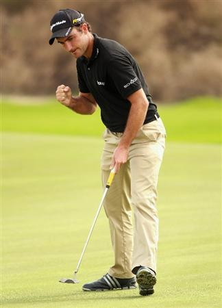 BAHRAIN, BAHRAIN - JANUARY 28:  Edoardo Molinari of Italy celebrates holing a putt on the fourth hole during the second round of the Volvo Golf Champions at The Royal Golf Club on January 28, 2011 in Bahrain, Bahrain.  (Photo by Andrew Redington/Getty Images)