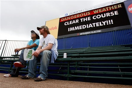 AVONDALE, LA - MARCH 29: Spectators sit and wait for a weather delay to clear during the Third Round of the Zurich Classic of New Orleans on March 29, 2008  at TPC Louisiana in Avondale, Louisiana.  (Photo by Chris Graythen/Getty Images)