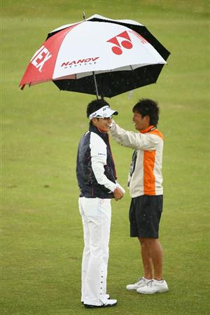 TURNBERRY, SCOTLAND - JULY 14:   Ryo Ishikawa of Japan has a laugh during a practice round prior to the 138th Open Championship on the Ailsa Course, Turnberry Golf Club on July 14, 2009 in Turnberry, Scotland. (Photo by Warren Little/Getty Images)