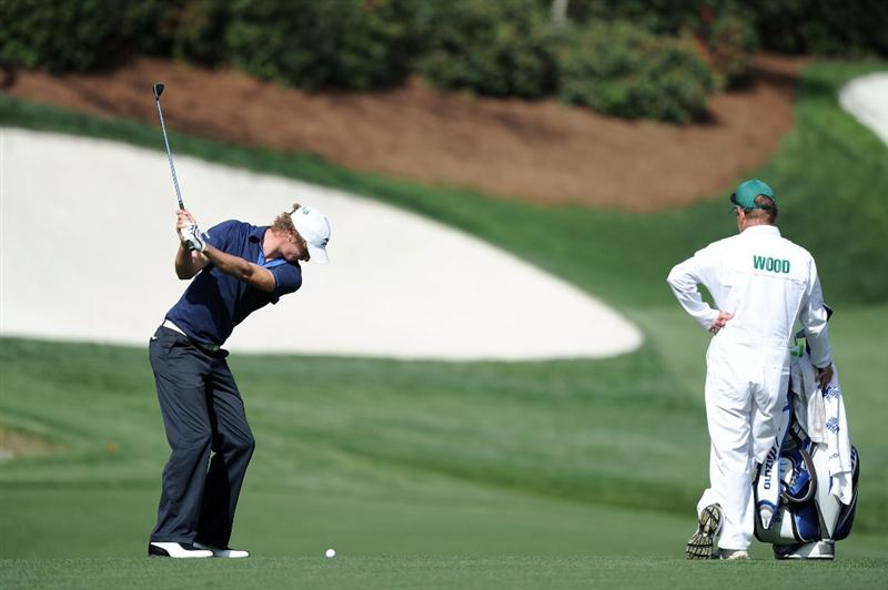 AUGUSTA, GA - APRIL 07:  Chris Wood of England hits a shot as his caddie Dave McNeilly looks on during a practice round prior to the 2010 Masters Tournament at Augusta National Golf Club on April 7, 2010 in Augusta, Georgia.  (Photo by Harry How/Getty Images)